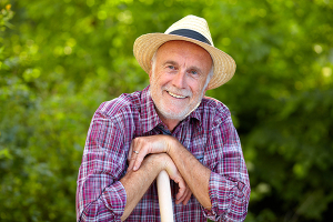 Portrait of senior gardener with straw hat
